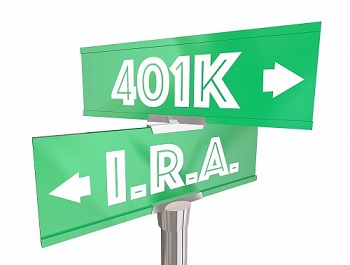 street signs pointing to 401k one way and ira another way