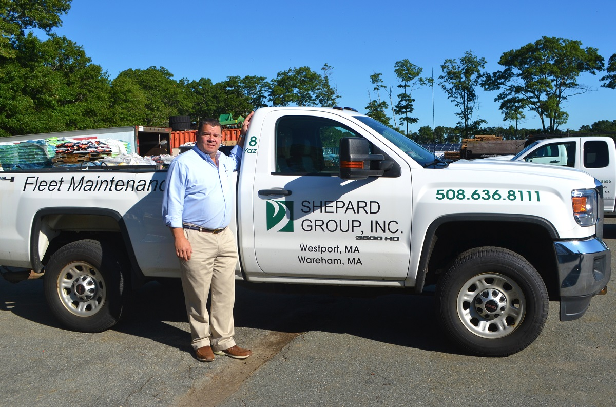 Don Giumetti, Owner of Shepard Group, Inc standing next to one of his company's trucks